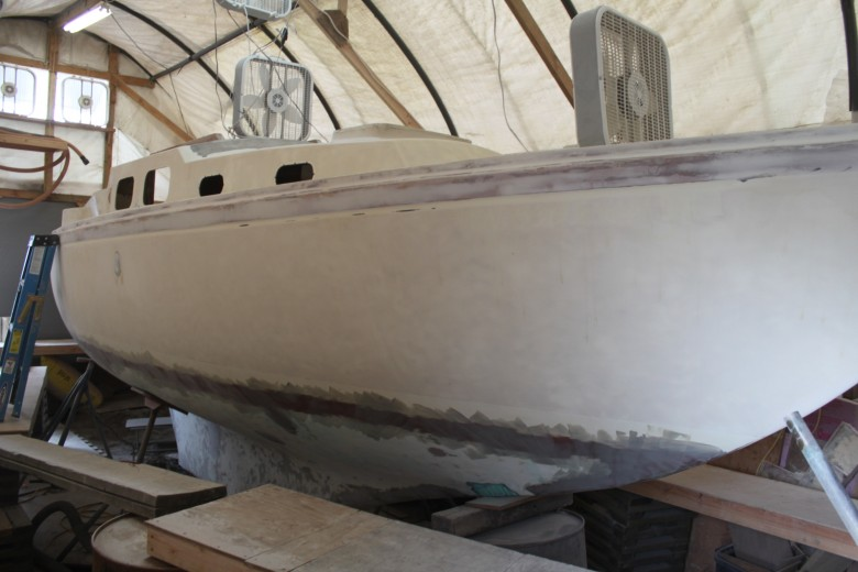 The exterior has been fully sanded.  The bottom has been faired several times and is nearly ready for primer.