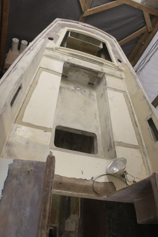 Cockpit showing coamings, deck locker lids, traveler, new cockpit sole (that drains aft) and cockpit sole access hatch.