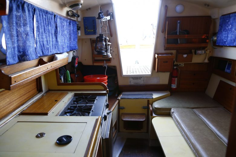 Here's Windspell's interior looking aft. Note the dinette shown folded down into a berth.