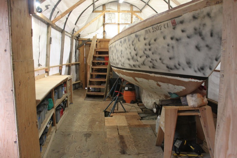 Floor space around boat is much improved.  That darn spray paint on the hull though - I will sand that off as soon as construction starts again!