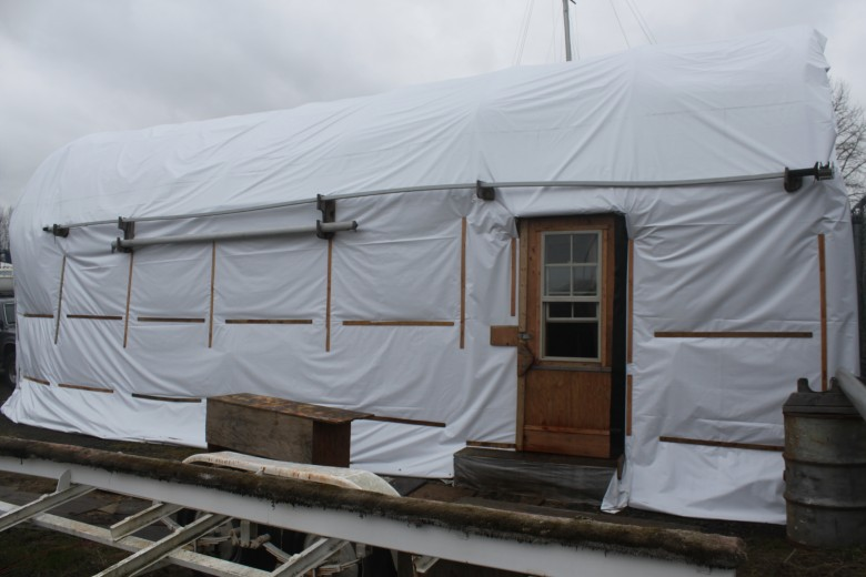 The east exterior of the boat shed.  Note the new tarp.  A new door was custom built by my Dad, that replaced the old screen door.