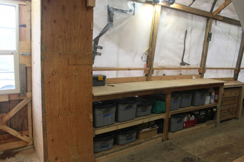 Long work bench and storage closet.